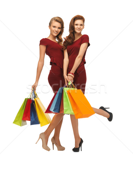 Vermelho vestidos quadro dois Foto stock © dolgachov