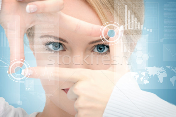 woman creating frame with fingers Stock photo © dolgachov