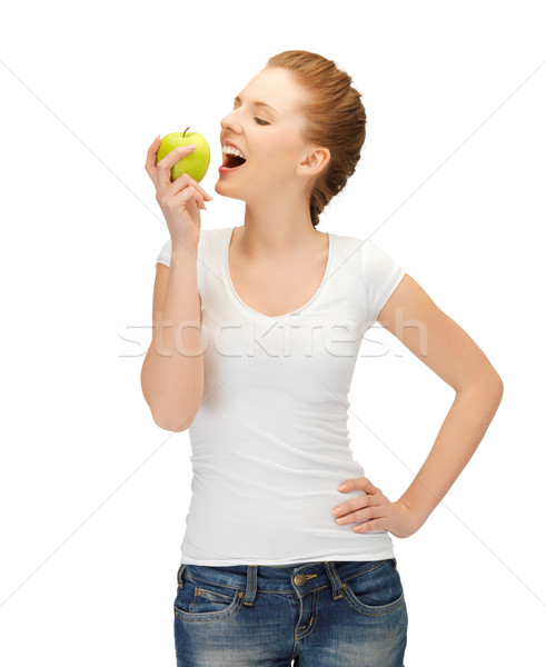 woman in blank t-shirt eating green apple Stock photo © dolgachov