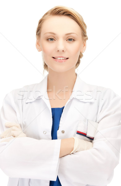 smiling female doctor in uniform Stock photo © dolgachov