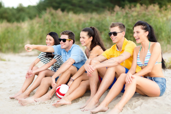 group of friends having fun on the beach Stock photo © dolgachov