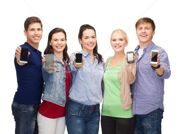 Diákok mutat okostelefonok oktatás modern technológia Stock fotó © dolgachov