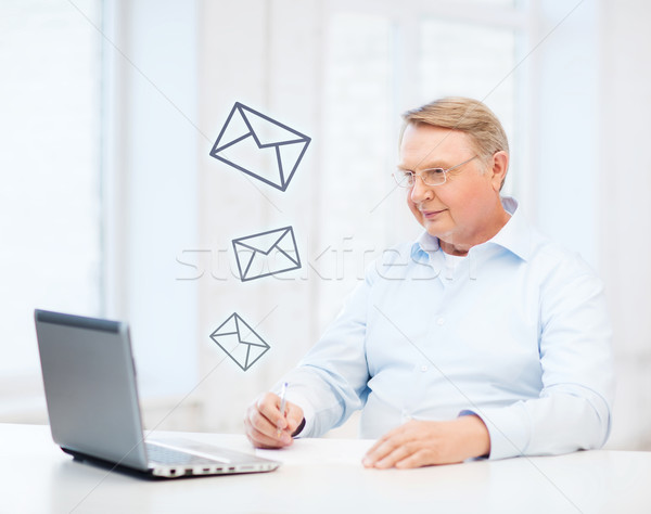 old man in eyeglasses filling a form at home Stock photo © dolgachov