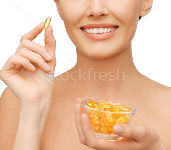 Bella donna omega 3 vitamine sanitaria bellezza donna Foto d'archivio © dolgachov