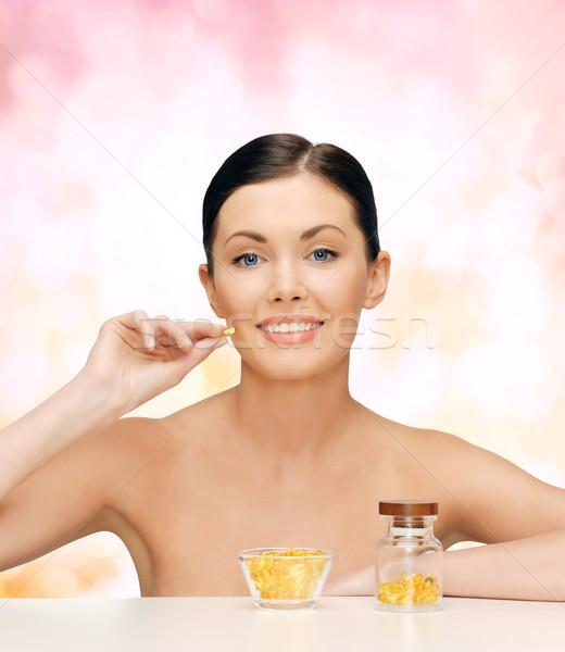 Güzel bir kadın omega 3 vitaminler sağlık güzellik kadın Stok fotoğraf © dolgachov