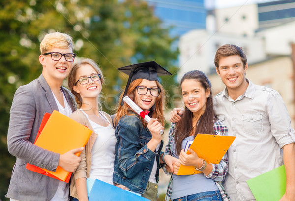 students or teenagers with files and diploma Stock photo © dolgachov