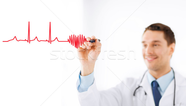 male doctor drawing heart in the air Stock photo © dolgachov