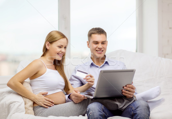 expecting family with laptop and credit card Stock photo © dolgachov