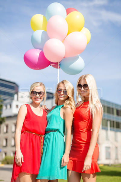 beautiful girls with colorful balloons in the city Stock photo © dolgachov