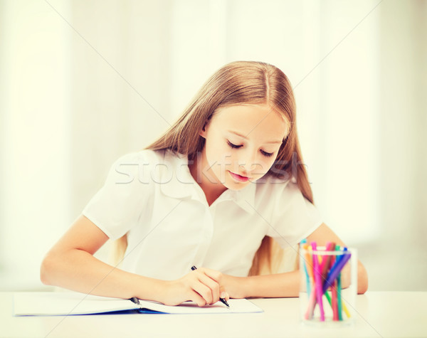 Stock photo: little student girl drawing at school