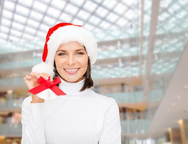 smiling woman in santa helper hat and jingle bells Stock photo © dolgachov