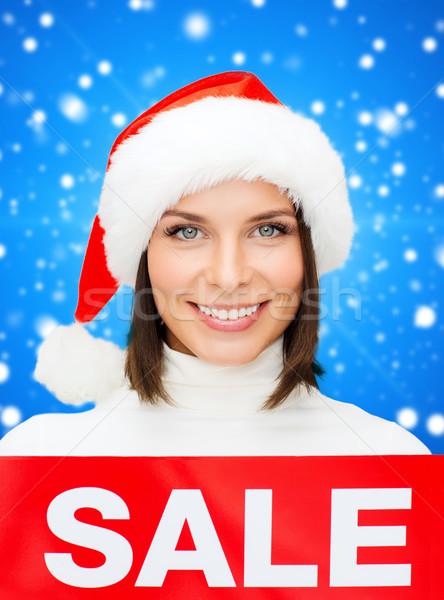 Gülümseyen kadın yardımcı şapka satış imzalamak Stok fotoğraf © dolgachov