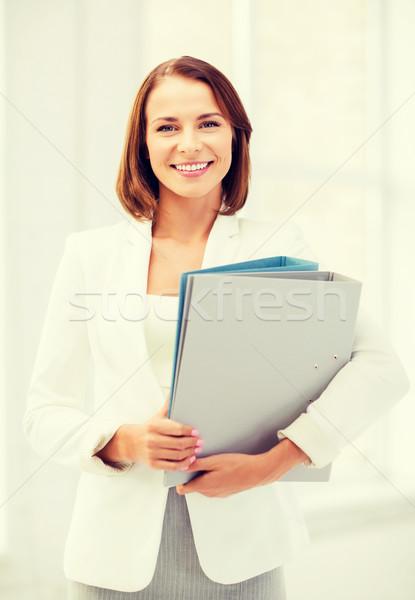 女性実業家 フォルダ オフィス ビジネス 笑みを浮かべて 魅力的な ストックフォト © dolgachov