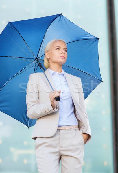 Genç ciddi işkadını şemsiye açık havada iş Stok fotoğraf © dolgachov