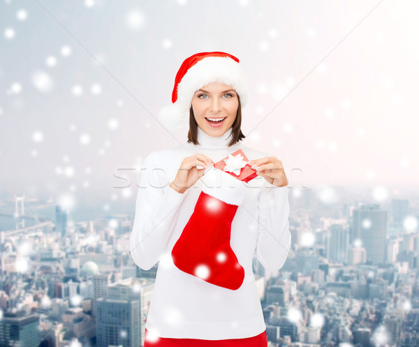 woman in santa hat with gift box and stocking Stock photo © dolgachov