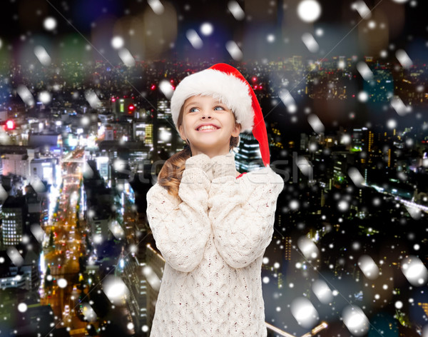 álmodik lány mikulás segítő kalap karácsony Stock fotó © dolgachov