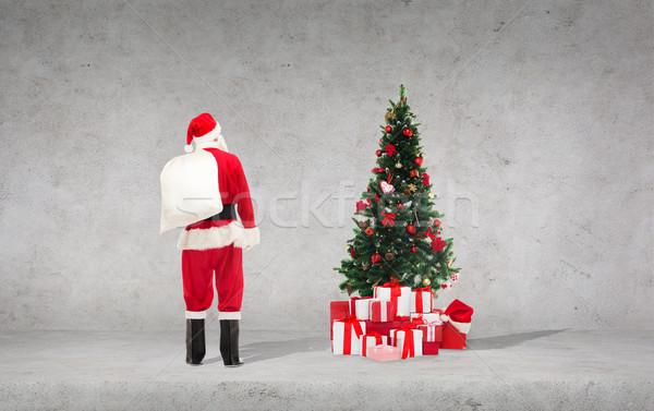 Homme costume sac vacances personnes Photo stock © dolgachov