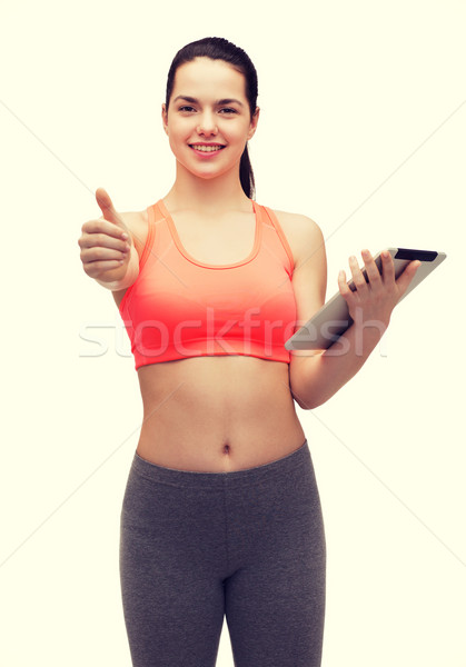 sporty woman with tablet pc computer Stock photo © dolgachov