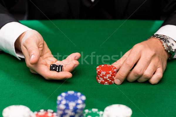poker player with dice and chips at casino Stock photo © dolgachov