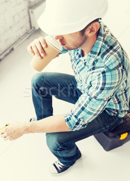 builder drinking take away coffee Stock photo © dolgachov