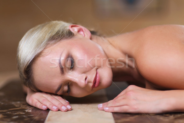 young woman lying on hammam table in turkish bath Stock photo © dolgachov