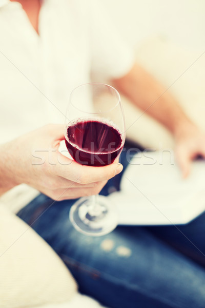 Férfi kéz könyv üveg vörösbor szabadidő Stock fotó © dolgachov