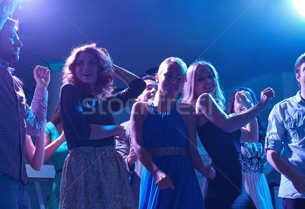 группа счастливым друзей танцы ночной клуб вечеринка Сток-фото © dolgachov