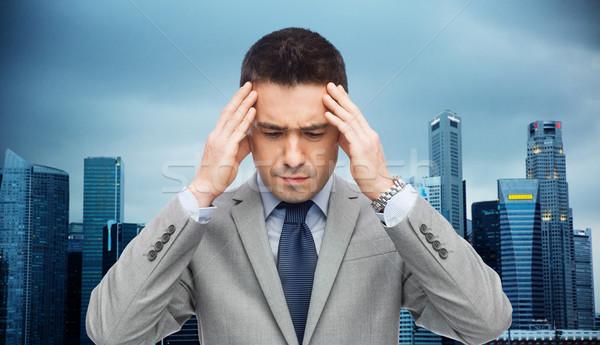 бизнесмен костюм голову боль деловые люди кризис Сток-фото © dolgachov