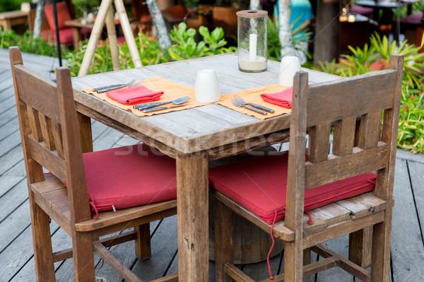 Közelkép evőeszköz üveg szalvéta asztal eszik Stock fotó © dolgachov