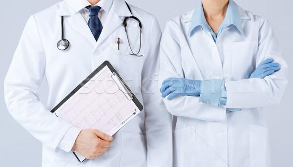 Nővér férfi orvos tart kardiogram kép nő Stock fotó © dolgachov