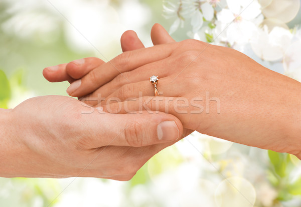 close up of man and woman hands with wedding ring Stock photo © dolgachov