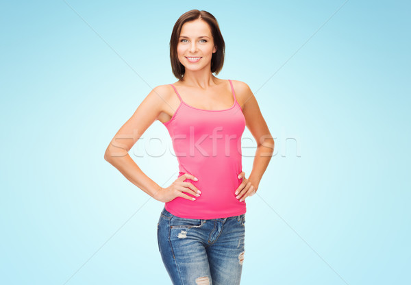 happy young woman in blank pink tank top over blue Stock photo © dolgachov