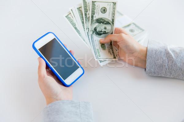 Femme mains smartphone argent affaires Photo stock © dolgachov