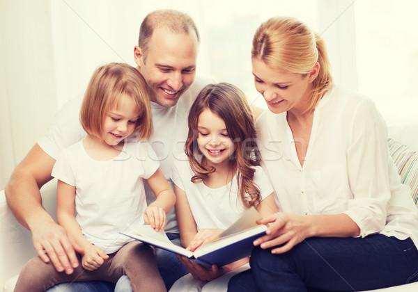 Mosolyog család kettő kislányok könyv gyerekek Stock fotó © dolgachov