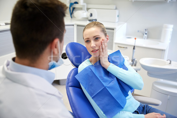 male dentist with woman patient at clinic Stock photo © dolgachov