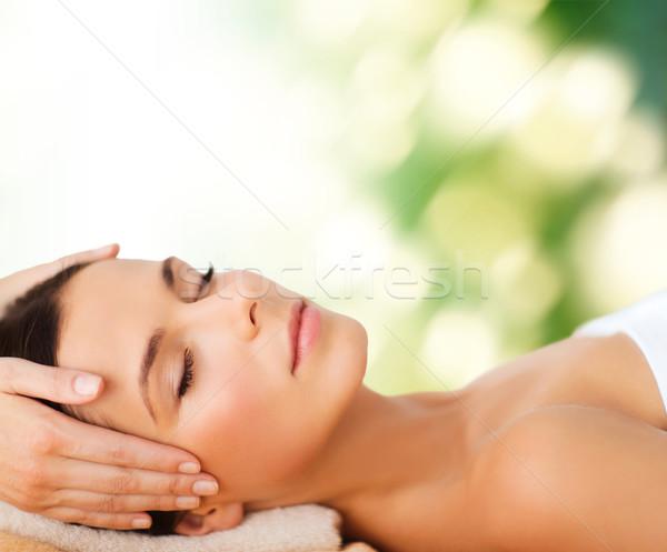 beautiful woman in spa salon having facial Stock photo © dolgachov