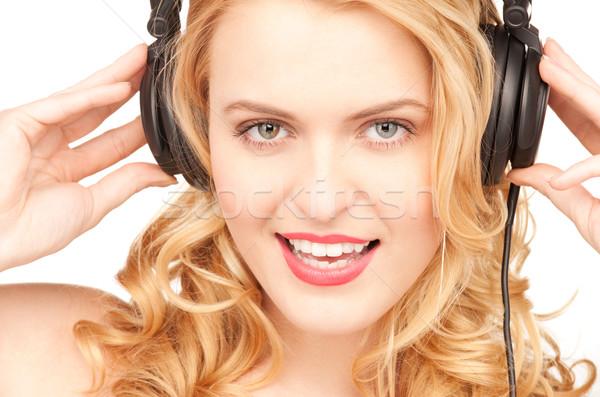 счастливым женщину наушники фотография белый музыку Сток-фото © dolgachov