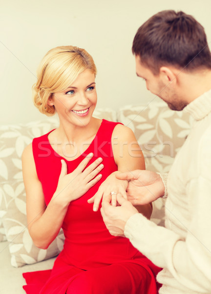 romantic man proposing to a woman in red dress Stock photo © dolgachov