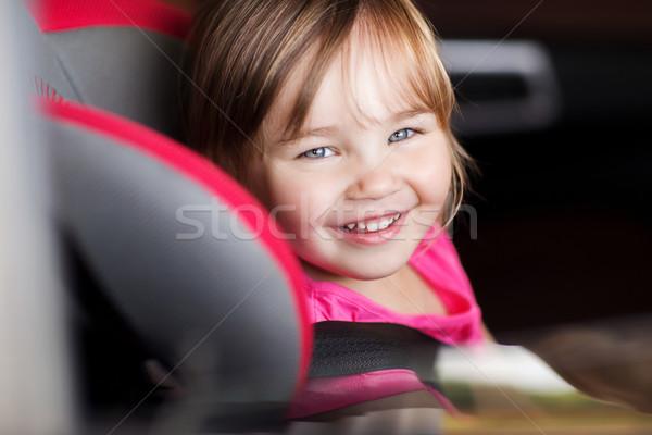 happy little girl sitting in baby car seat Stock photo © dolgachov