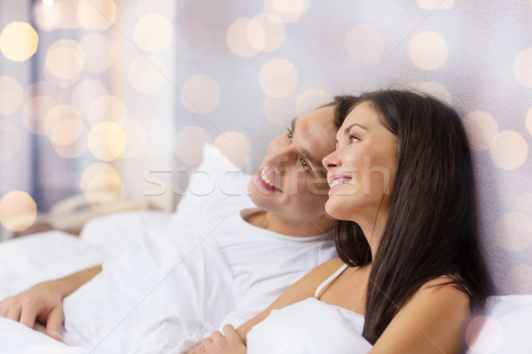 happy couple dreaming in bed Stock photo © dolgachov