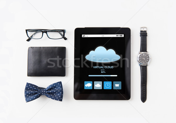 tablet pc with cloud computing and personal stuff Stock photo © dolgachov