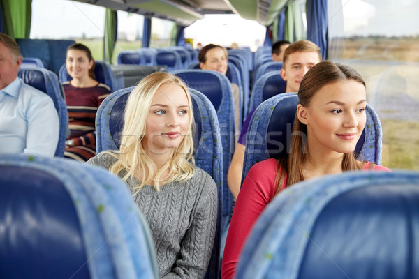 happy young women riding in travel bus Stock photo © dolgachov