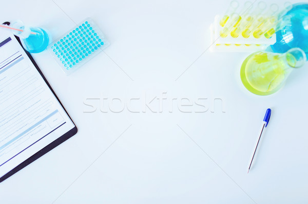 close up of scientific laboratory table with stuff Stock photo © dolgachov