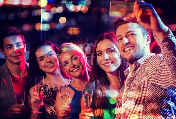 Amis smartphone night-club fête vacances Photo stock © dolgachov