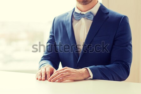 close up of male gay couple with champagne glasses Stock photo © dolgachov