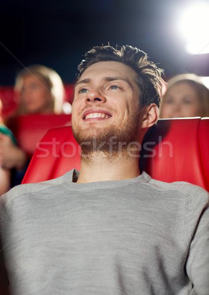 Boldog fiatalember néz film színház mozi Stock fotó © dolgachov