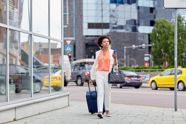 african woman with travel bag and smartphone Stock photo © dolgachov
