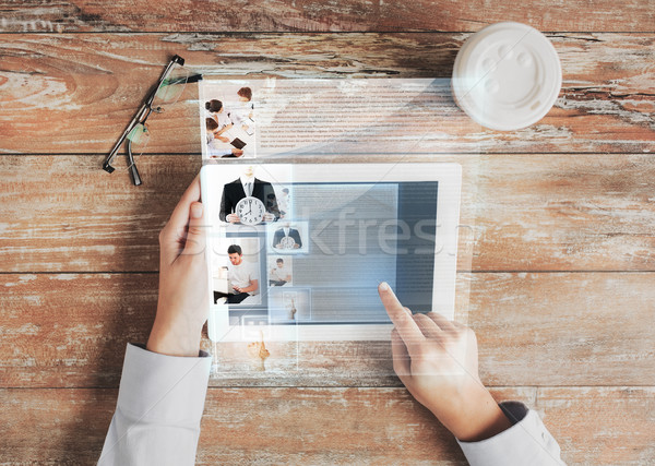 close up of hands with tablet pc and web page Stock photo © dolgachov
