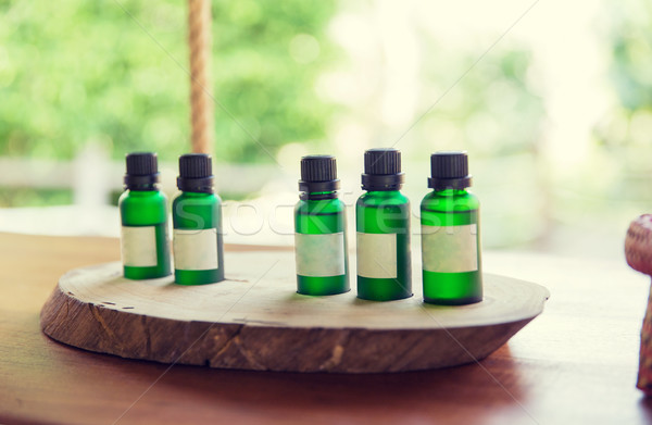 close up of aromatic oil bottles set at hotel room Stock photo © dolgachov