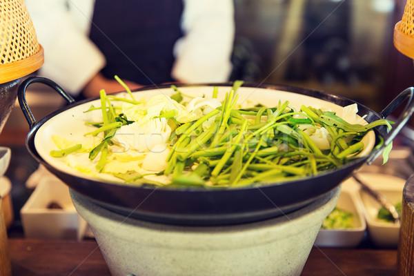 bowl of green salad or garnish at asian restaurant Stock photo © dolgachov